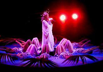 """Aphrodite: Les Folies Tour - Minogue performing """"Slow"""" at the Palais Omnisports de Paris-Bercy"""