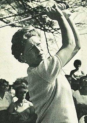 Marilynn Smith - Smith follows the flight of her ball