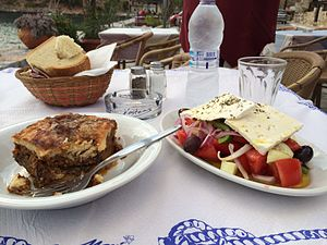 Greek salad - Horiatiki salad served together with moussaka in Lavonia, Peloponnesus