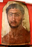 Mummy portrait of a Petrie's red youth from Fayum, Hawara. Roman Period. Petrie Museum.jpg