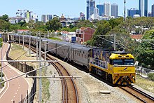 NR28 in Indian Pacific livery with the eastbound Indian Pacific at Mt Lawley, 2014.