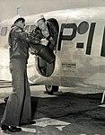 Naval Photography School students loading aerial camera on to a plane at NAS Pensacola (9025677298).jpg