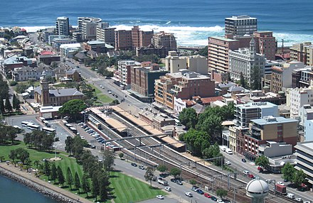 Newcastle's East End in 2008 with Newcastle railway station in the centre. The buildings at right are within the Dangar Grid, designed in 1823. Newcastle's East End.jpg
