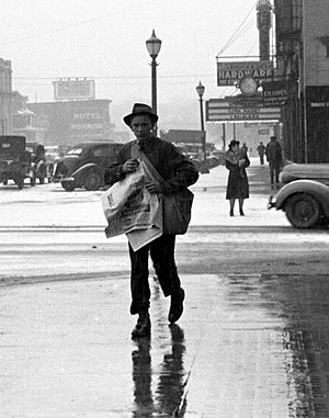 Paperboy - Newsboy, Iowa City, 1940, Arthur Rothstein.