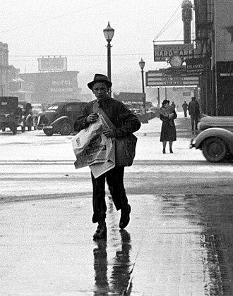 Paperboy - Newsboy, Iowa City, 1940, Arthur Rothstein.