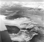 Norris and Taku Glaciers, terminus of valley glacier and braided stream near terminus, August 27, 1969 (GLACIERS 6066).jpg