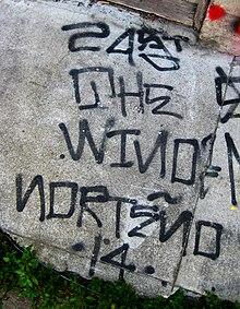 Tagging Graffiti To Vandalize A Rival Gangs Territory