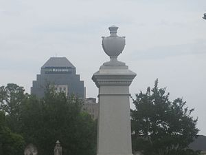 "Shreveport, Louisiana - ""The Old and the New"": Tall monument in Shreveport's historic Oakland Cemetery, which dates to 1847, is seen with the distant Regions Bank Tower, the city's tallest building, behind it."