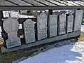 Old tombstones on display at the graveyard (kirkegård) by Sør-Fron Church (Gudbrandsdalsdomen kirke 1792) Hundorp Gubrandsdalen Norway 2017-03-23 Spring sun IMG 1948.jpg