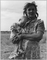 On Arizona Highway 87, south of Chandler, Arizona. Grandmother and sick baby of migratory family ca . . . - NARA - 522263.tif
