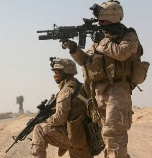 United States Marine Corps - A Marine Corporal and Lance Corporal of 3rd Battalion, 6th Marines engaging the enemy during Operation Moshtarak in Afghanistan's Helmand Province.