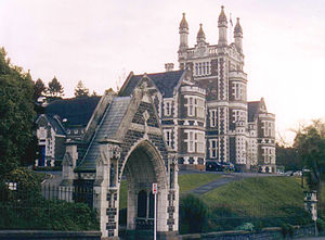 Robert Lawson (architect) - Otago Boys' High School: The ecclesiastical entrance arch leads to an extravaganza of turrets and gables. the central tower is crowned by Tudor pinnacles, above a renaissance balustrade.