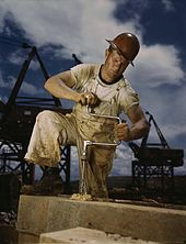 Carpenter (wearing a union badge) at work during the 1942 construction of the Douglas Dam in East Tennessee.
