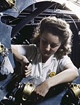 Part of the cowling for one of the motors for a B-25 bomber is assembled in the engine department of North American Aviation (cropped).jpg