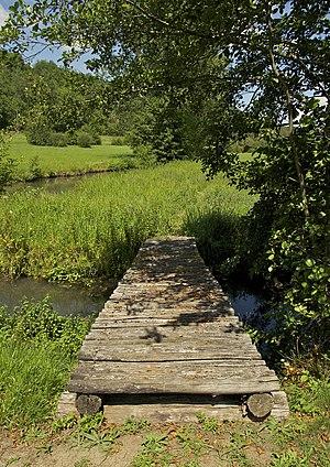 Beam bridge - A footbridge using beams over a stream in Dordogne, France