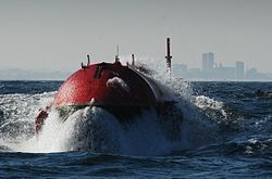 Pelamis bursts out of a wave.JPG