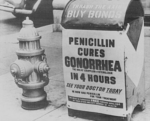 A poster on a mailbox advising World War II servicemen that penicillin cures gonorrhoea in 4 hours (click to embiggen)
