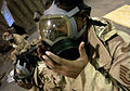 Personnel recently assigned to the 410 Air Expeditionary Wing (AEW), at a forward deployed location, don their MCU-2A-P protective masks during a Right Start program to get them familiarized with base procedures 030228-F-VY627-001.jpg