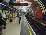 Piccadilly Circus tube stn Piccadilly westbound look east.JPG