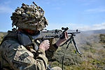 Pictured is a soldier of First Fusiliers operating a GPMG during a section level attack. MOD 45156947.jpg