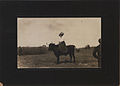Pioneer Woman seated on bull (HS85-10-23252).jpg