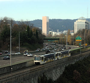 MAX Light Rail - A Red Line train on the Banfield Mainline next to Interstate 84