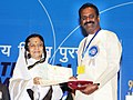 Pratibha Devisingh Patil presenting the Rajat Kamal Award to Shri Vairamuthu for the Best Lyrics (Tamil Thenmerkku Paruvakkatru), at the 58th National Film Awards function, in New Delhi on September 09, 2011.jpg