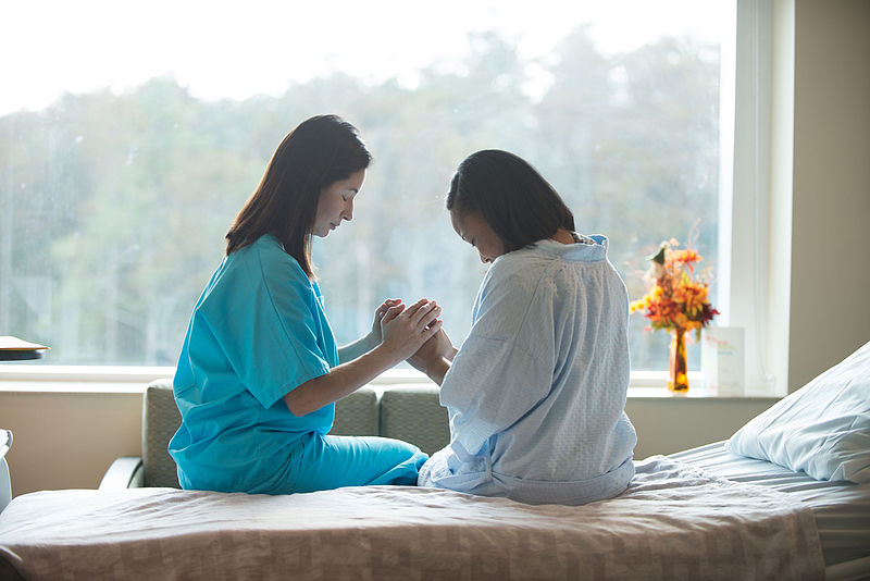 File:Praying with Patient.jpg