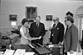 President Gerald R. Ford and First Lady Betty Ford Looking at Photographs in the Oval Office with Ansel Adams and William Turnage - NARA 27575790.jpg