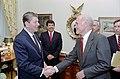 President Ronald Reagan shaking hands with John Glenn.jpg