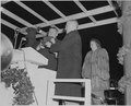 President Truman lights the White House Christmas Tree during ceremonies outside the White House. Daughter Margaret... - NARA - 199663.tif