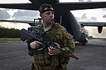 RAAF security forces member with a C-130J Hercules during Cope North 2018.jpg