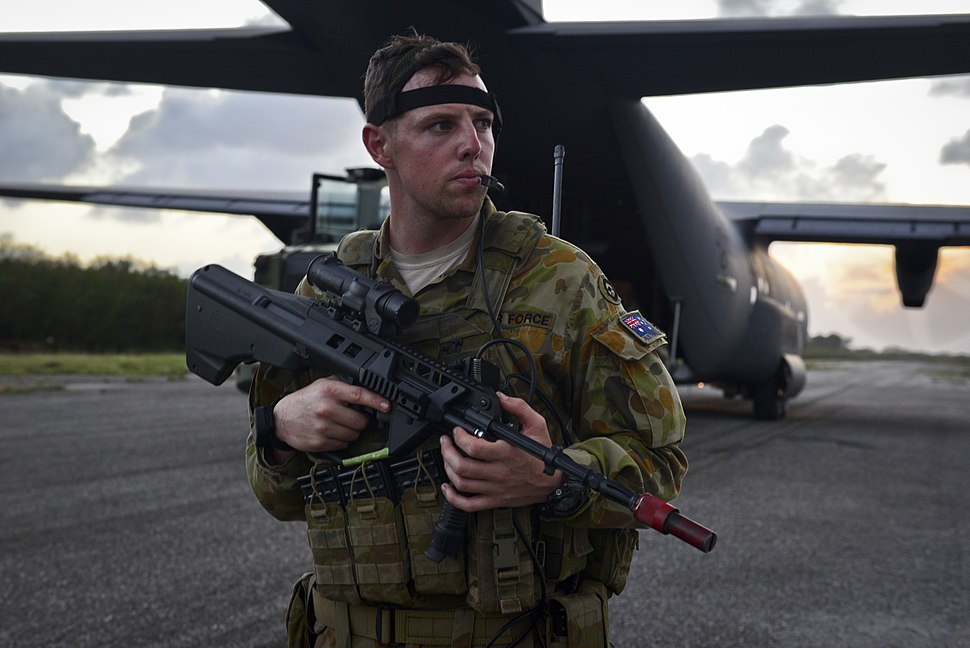 RAAF security forces member with a C-130J Hercules during Cope North 2018