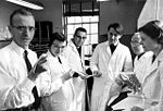 Nobel Prize winner Robert W. Holley (left) and team members determine the molecular structure of RNA.