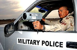 Radar gun - U.S. Army soldier uses a radar speed gun to catch speeding violators at Tallil Air Base, Iraq.