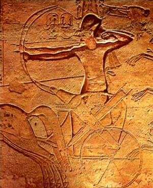 Chariot - Ramses II fighting from a chariot at the Battle of Kadesh with two archers, one with the reins tied around the waist to free both hands (relief from Abu Simbel)
