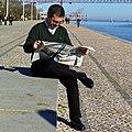Reading the weekly newspaper (16215479327).jpg