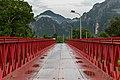 Red metal bridge over the Nam Song River front view in Vang Vieng Laos.jpg
