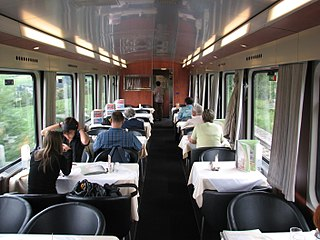 Dining car rail vehicle serving meals cooked on board