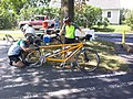 Rider fixing Cannondale tandem bicycle Shenandoah Valley Bicycle Festival Our Community Place Timberville VA July 2012.jpg
