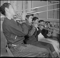 Rohwer Relocation Center, McGehee, Arkansas. A trombone section of the High School Band in a pract . . . - NARA - 539376.tif