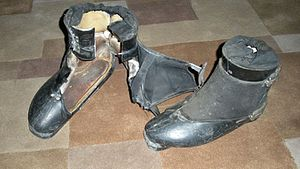 "Ski boot - Rosemount's side-entry design, circa 1968. The metal framework that provides forward flex is not visible in these images. The ""crushed"" section at the top of the boot is an elastic material that prevents snow from entering the cuff."