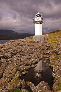 Rubha Cadail lighthouse, with reflection in rockpool - geograph.org.uk - 595073.jpg