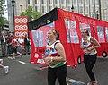 Running with a bus - London Marathon 2011 (5630055609).jpg
