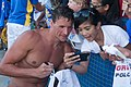 Ryan Lochte takes photo with fan (8990265373).jpg
