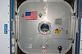 STS-135 Harmony's hatch with U.S. flag.jpg