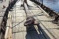 Saga Oseberg Details Wood deck Planks Gunwale (reling) Wrapped-in sail on yard (rå bom) Mast oars (årer) Ropes (tau) Towards stern (akter) Sunlight Viking ship replica 2012 Tønsberg harbour, Norway 2019-08-29 05657.jpg