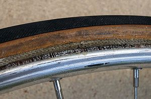 Tubular tyre - Tubular tyre rolled from rim to show glue between them