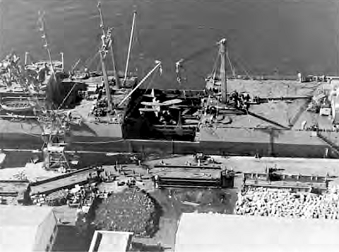USS Lakehurst (formerly Seatrain New Jersey), after discharging medium tanks at Safi, Morocco. Seatrain Lakehurst after discharging tanks at Safi North Africa.png