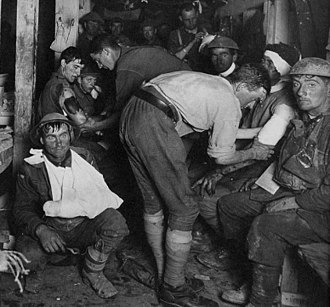 Male hysteria - Ypres, 1917. In the lower left, a shell-shock sufferer.